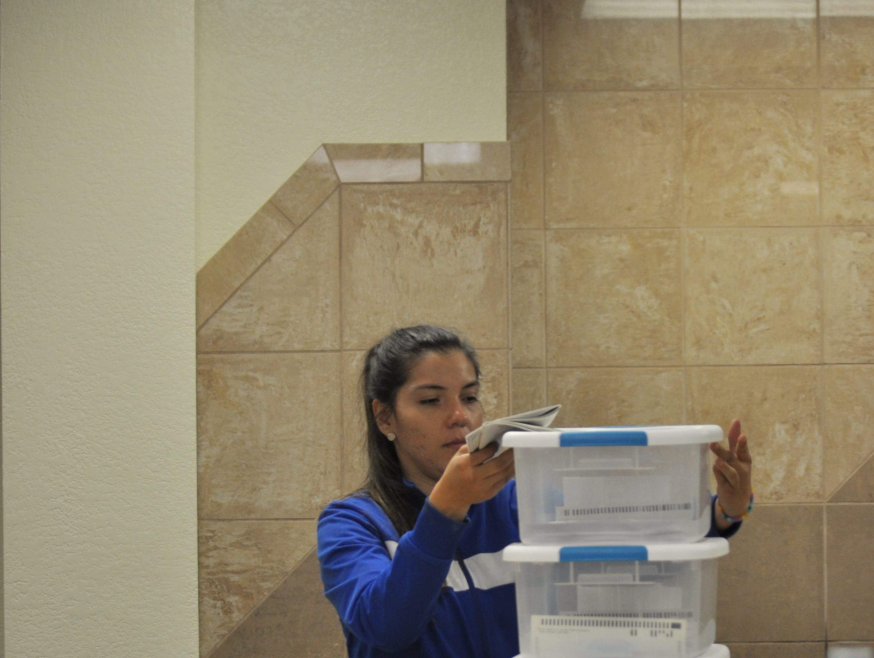 A poll worker delivers ballots to the Eddy County Bureau of Elections Oct. 6 following the close of polling locations in the general election.