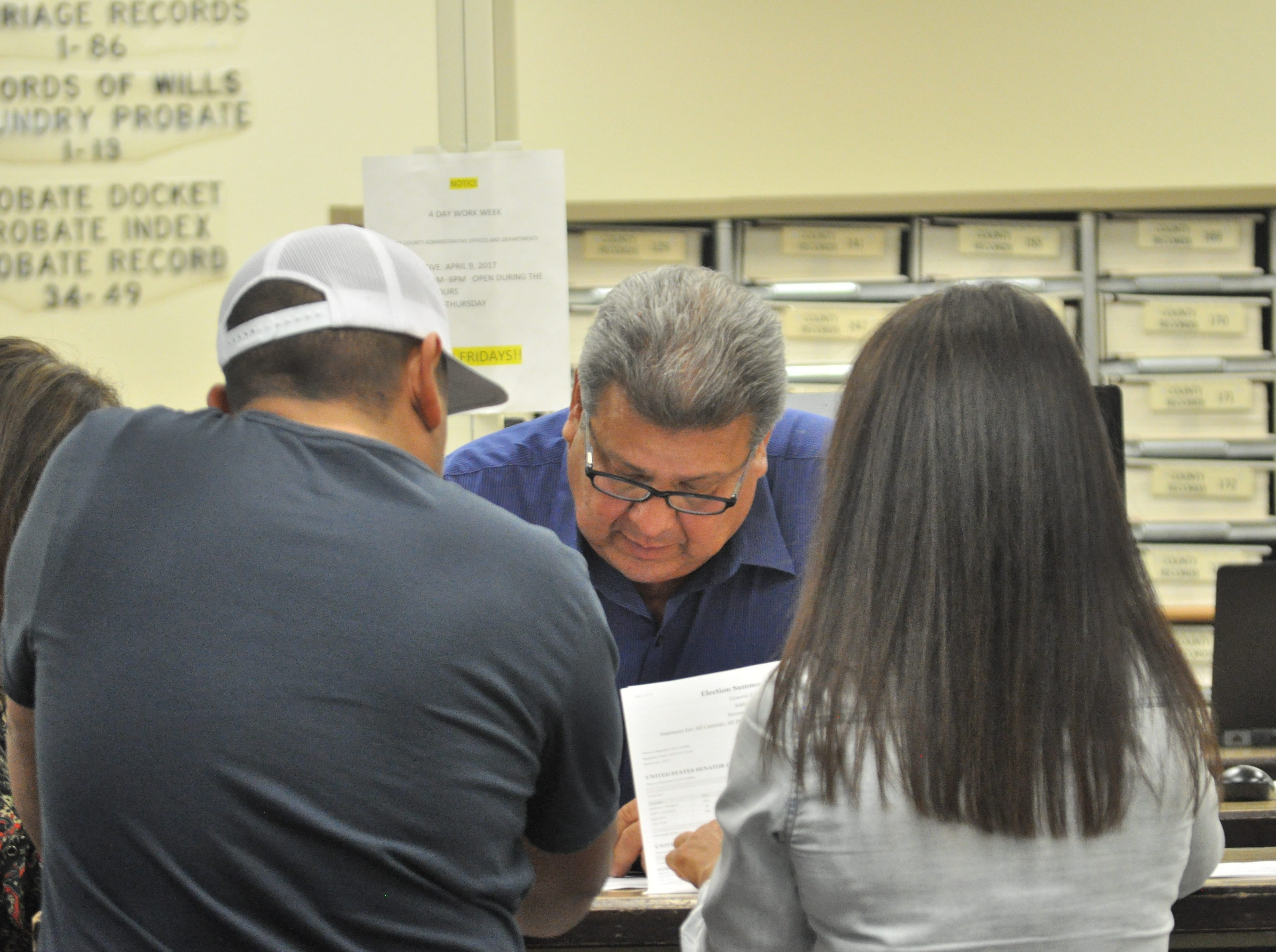 Tony Hernandez, Democratic candidate for Eddy County Board of Commissioner District 1, reviews early voting numbers Oct. 6 at the Eddy County Clerk's Office.