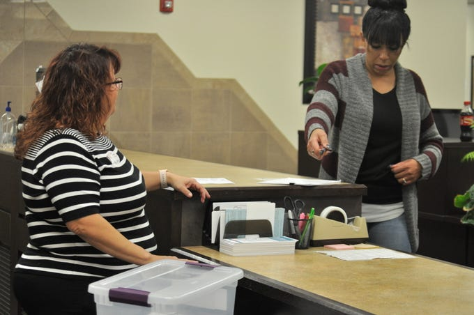 A poll worker delivers ballots to the Eddy County Bureau of Elections Oct. 6 following the close of polling locations in Eddy County.