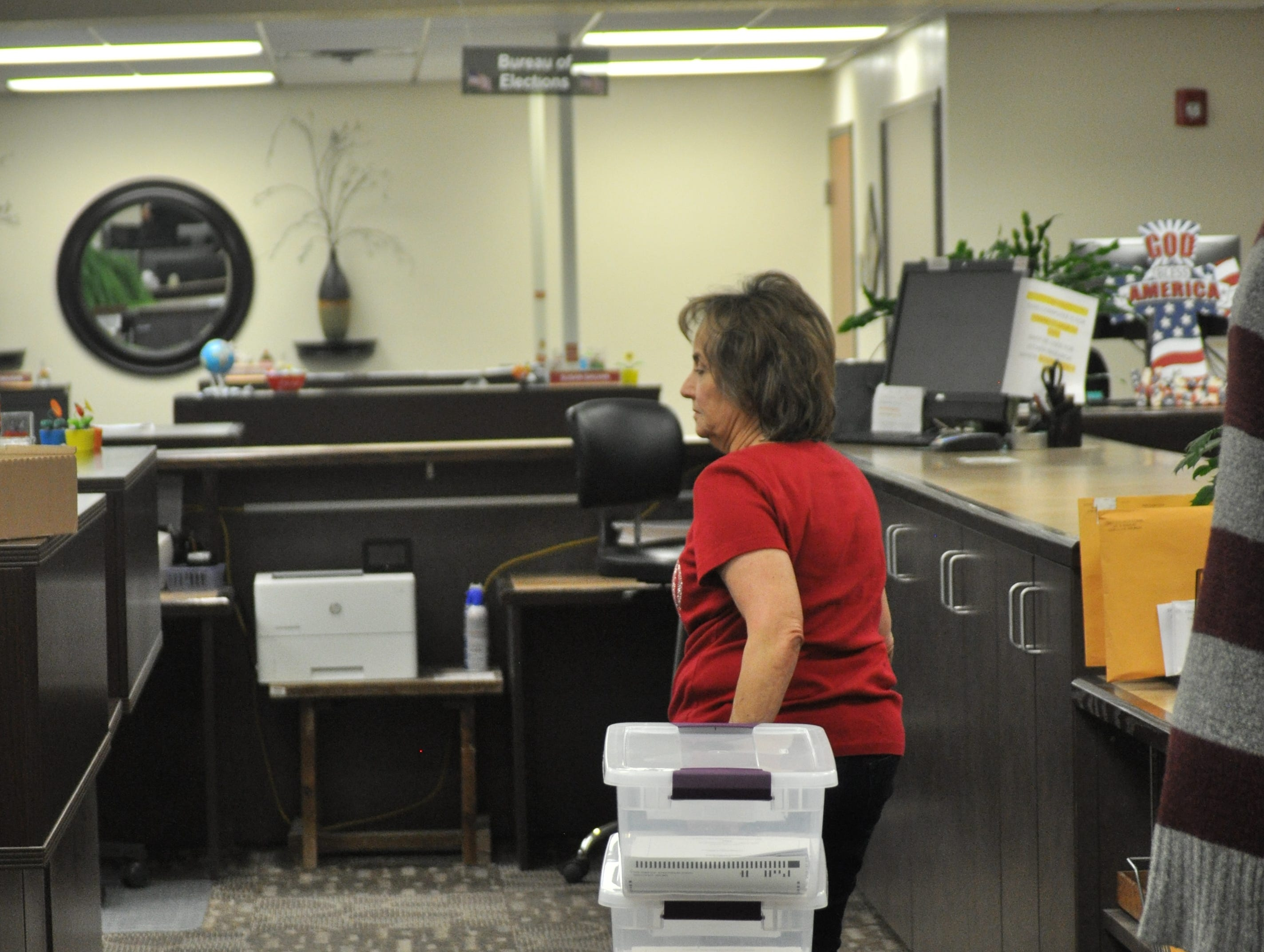 An employee of the Eddy County Bureau of Elections receives ballots from voting convenience centers Oct. 6.