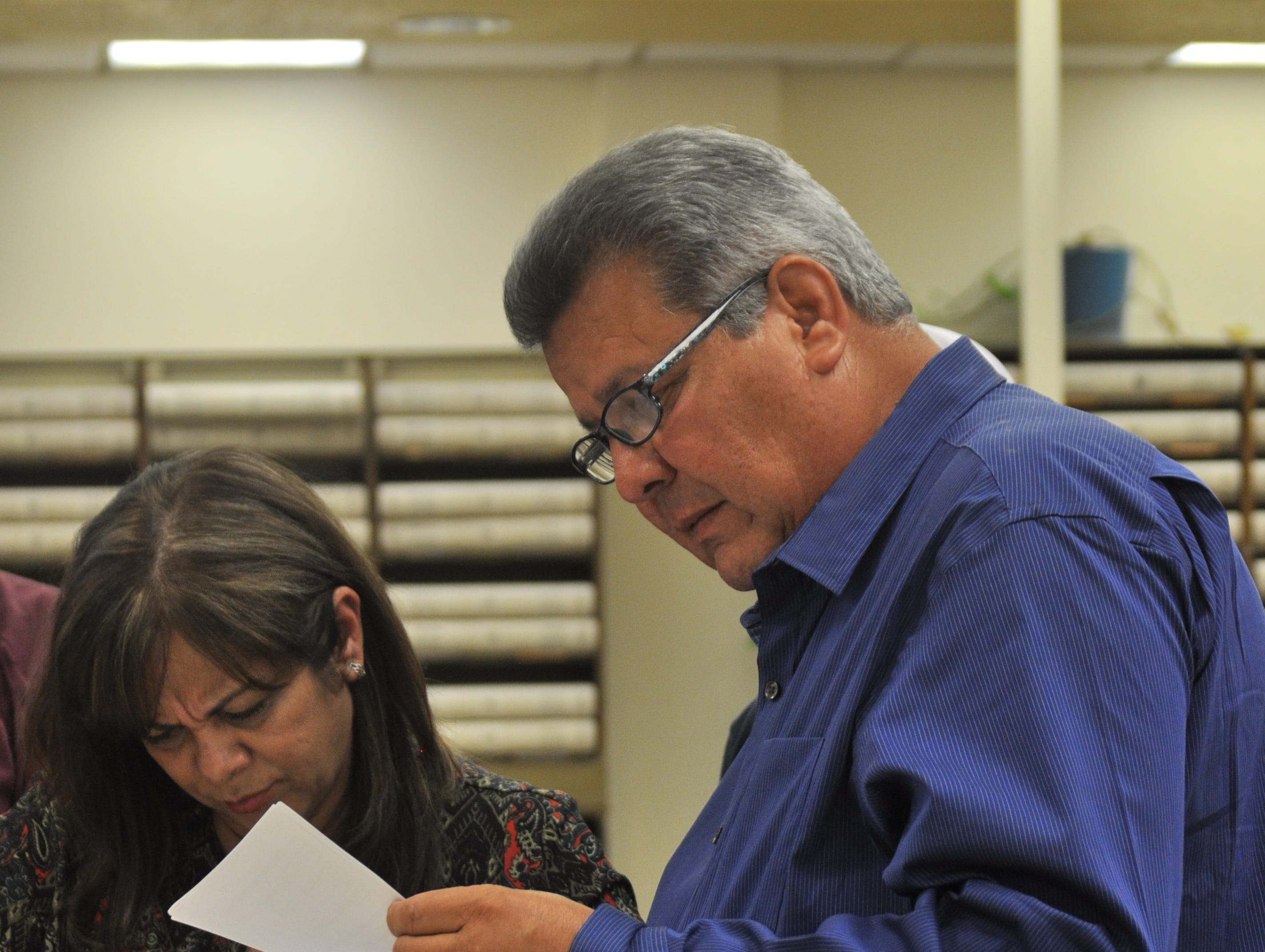 Tony Hernandez, Democratic candidate for the Eddy County Board of Commissioners District 1, reviews elections results with his family Oct. 6 at the Eddy County Clerk's Office.
