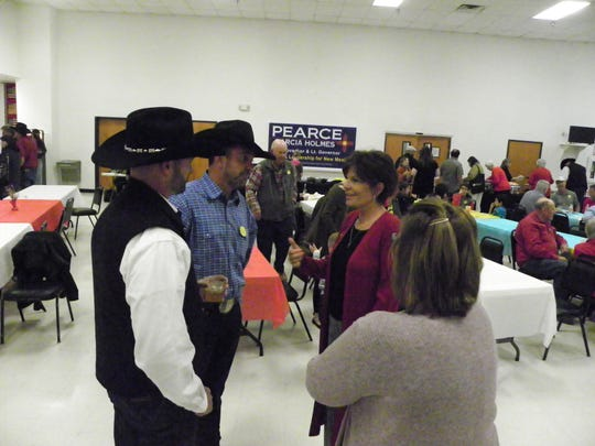US Congresswoman Yvette Herrell speaks with Otero County Magistrate Judge Michael Suggs, left, and Otero County Commissioner Couy Griffin at the Republican Party's gathering at the Elk's Lodge on election night.