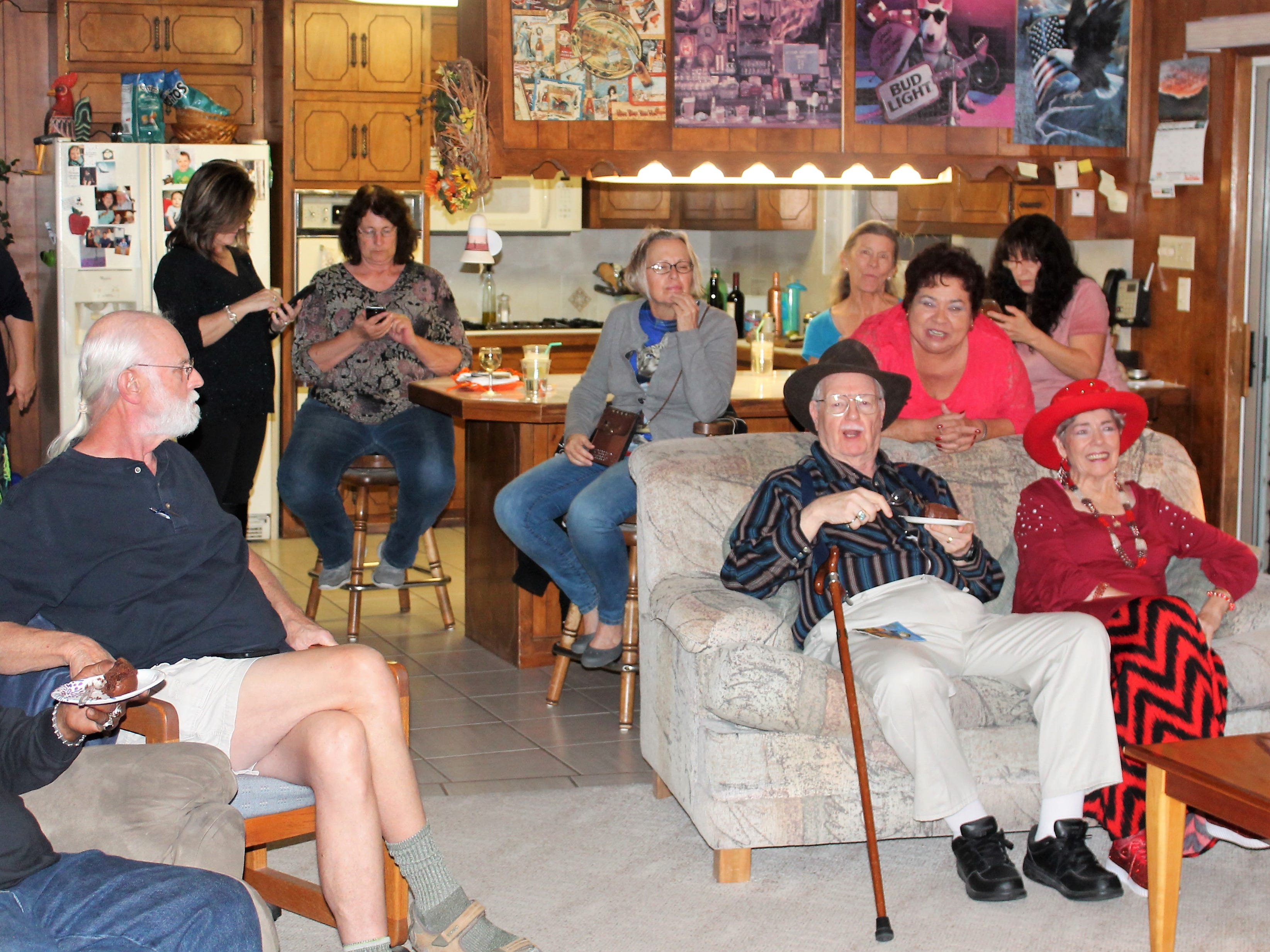 Members of the Democratic Party of Otero County enjoy snacks, beverages and conversation at the Pingal home in Alamogordo Tuesday night.