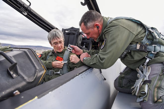 U.S. Air Force Col. Jeff Smith, 173rd Fighter Wing commander, right, helps Secretary of the Air Force, Heather Wilson strap into an F-15D Eagle before a familiarization flight Nov. 4, 2018, at Kingsley Field in Klamath Falls, Ore. The secretary's visit provided her a first-hand look at the wing's mission as the sole provider of F-15C air superiority pilots to the U.S. Air Force.