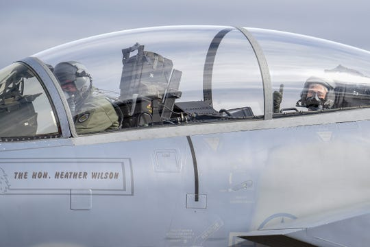 Secretary of the Air Force, Heather Wilson, right, gives a thumbs up as the engines of the F-15D Eagle start up before a familiarization flight Nov. 4, 2018, at Kingsley Field in Klamath Falls, Ore. The secretary's visit provided her a first-hand look at the wing's mission as the sole provider of F-15C air superiority pilots to the U.S. Air Force.