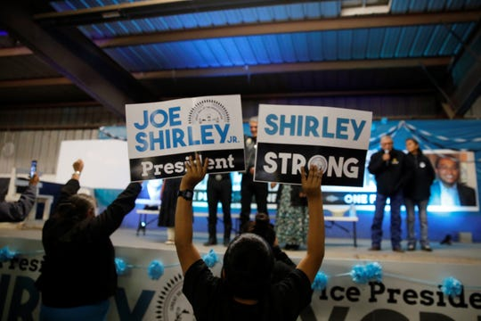A Joe Shirley Jr. supporter continues to show support despite the campaign loss for the Navajo Nation presidency on Tuesday night in Window Rock, Ariz.