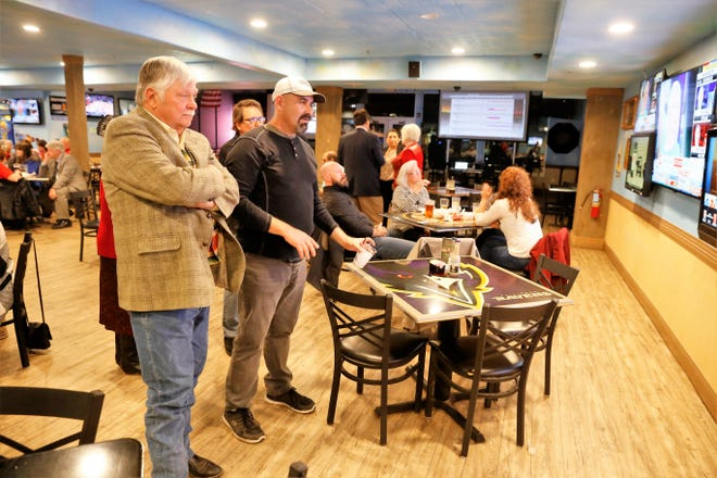 Incumbent state Rep. Paul Bandy, R-Aztec, left, watches the election results with Rep. Rod Montoya, R-Farmington, at the No Worries Sports Bar and Grill in Farmington on Tuesday. Both state lawmakers were re-elected easily.