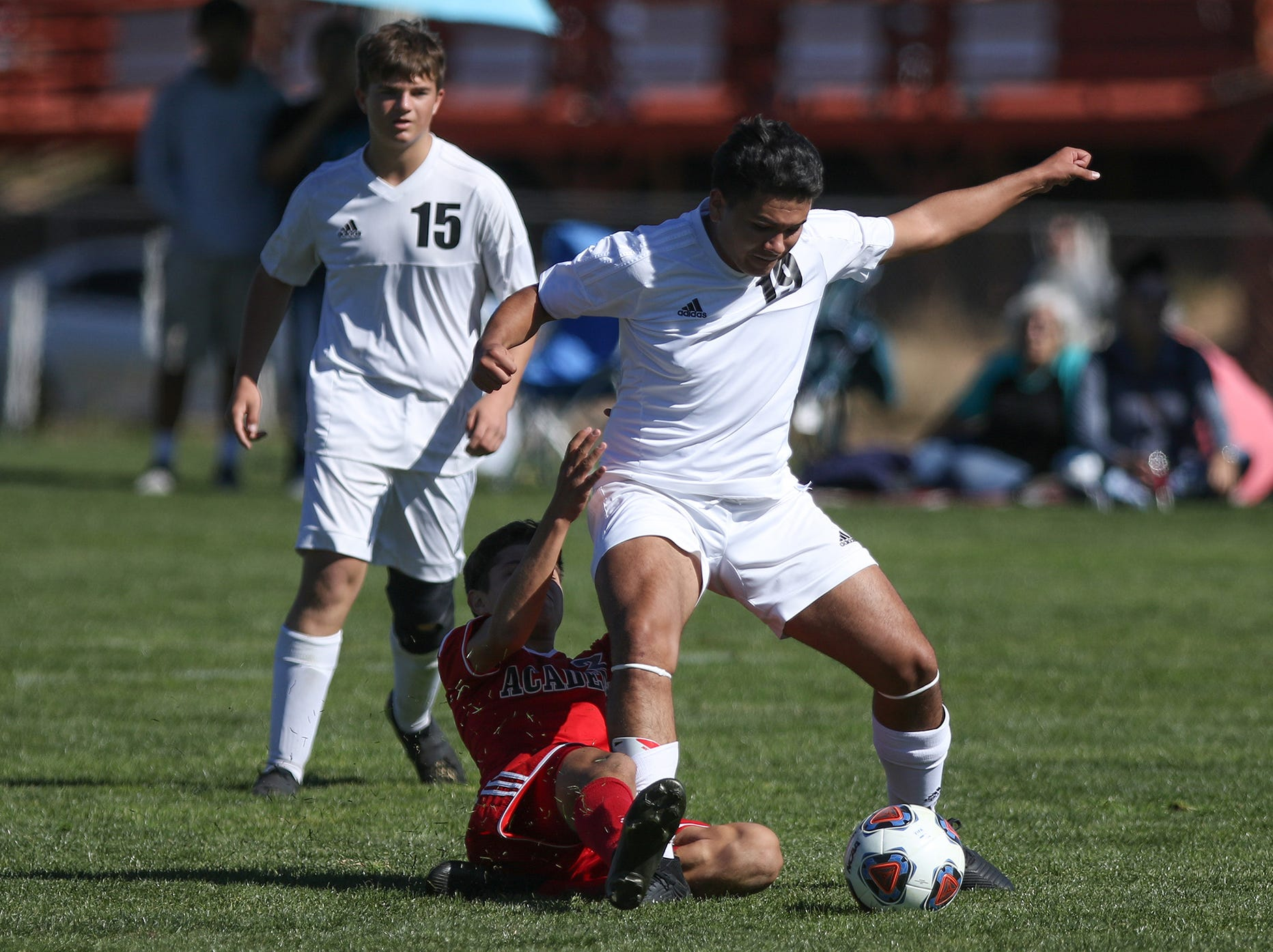 Aztec's Malakai Garcia (19) battles Albuquerque Academy's Case Manifold for possession of the ball during Wednesday's 4A state quarterfinals in Bernalillo.