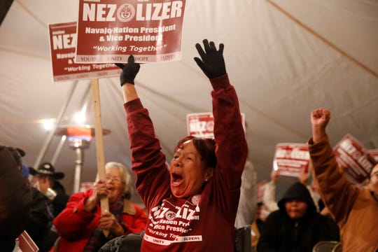 Fort Defiance, Ariz. resident Roselinda Anderson cheers for Navajo Nation presidential candidate Jonathan Nez and vice presidential candidate Myron Lizer on Tuesday night in Window Rock, Ariz.
