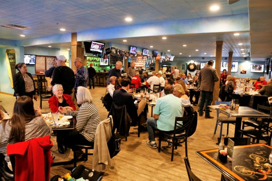 Members of the San Juan County Republican Party watch the election results during a party Tuesday at the No Worries Sports Bar and Grill in Farmington.