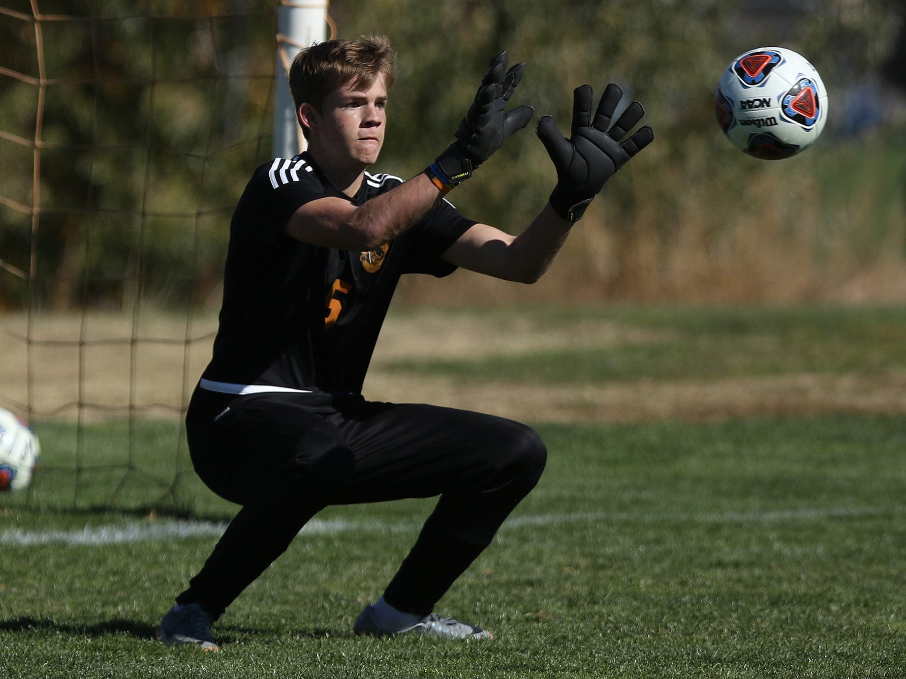 Aztec's goalkeeper Ethan Magee defends a goal attempt by Albuquerque Academy during Wednesday's 4A state quarterfinals in Bernalillo.