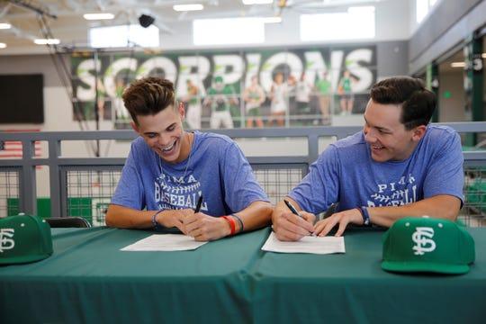 Farmington's Bradon Zastrow, left, and Wyatt Lawley signed with Pima Community College's baseball program on Wednesday.