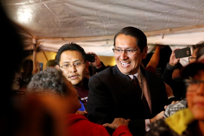 Navajo Nation presidential candidate Jonathan Nez arrives to his campaign's party on Tuesday night in Window Rock, Ariz.