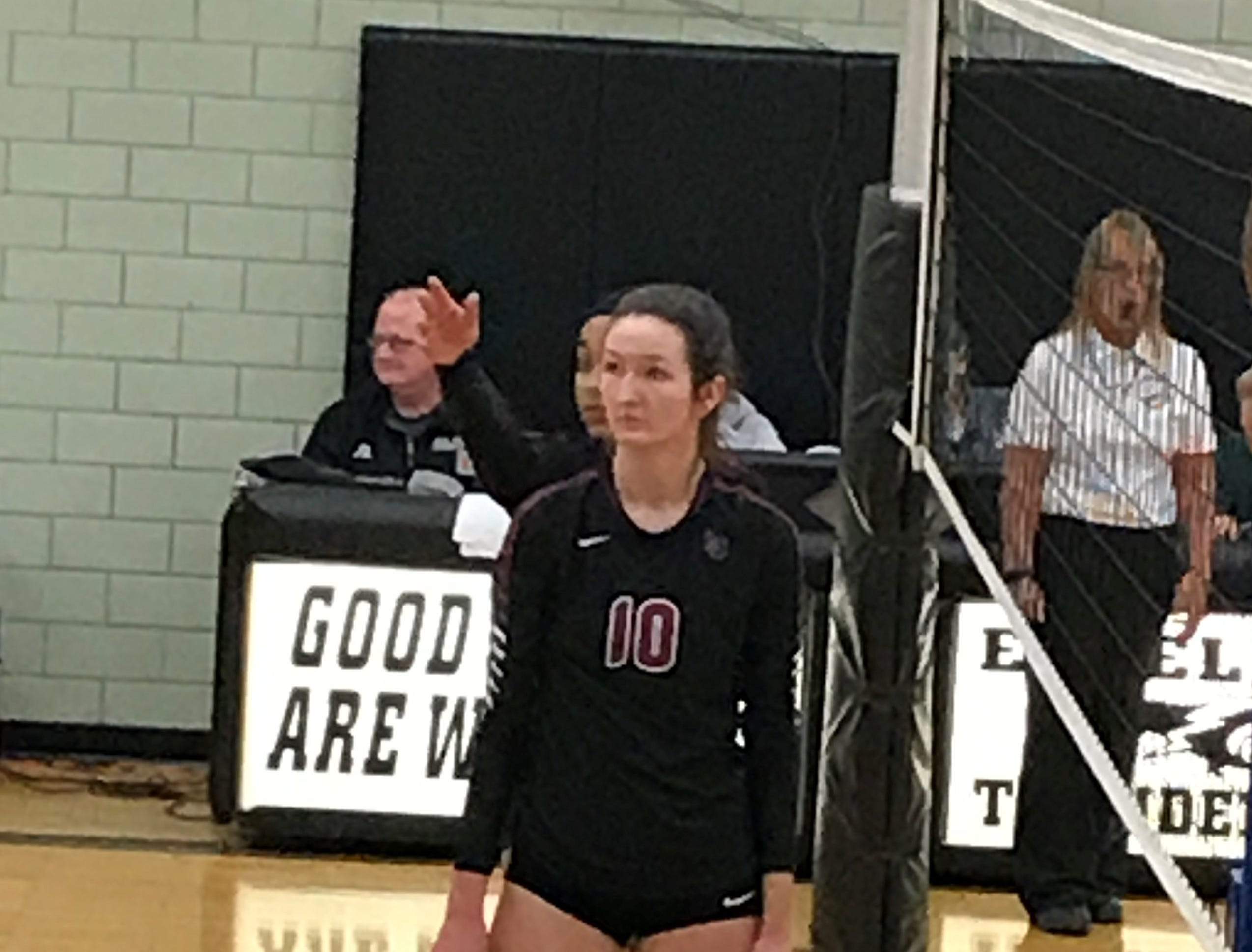 Livonia Churchill senior outside hitter Mary Claire Yost (10) is ready at the net.