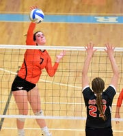Northville's Eleanor Knight (7) swings away against Bedford's Alyssa Griner (27).