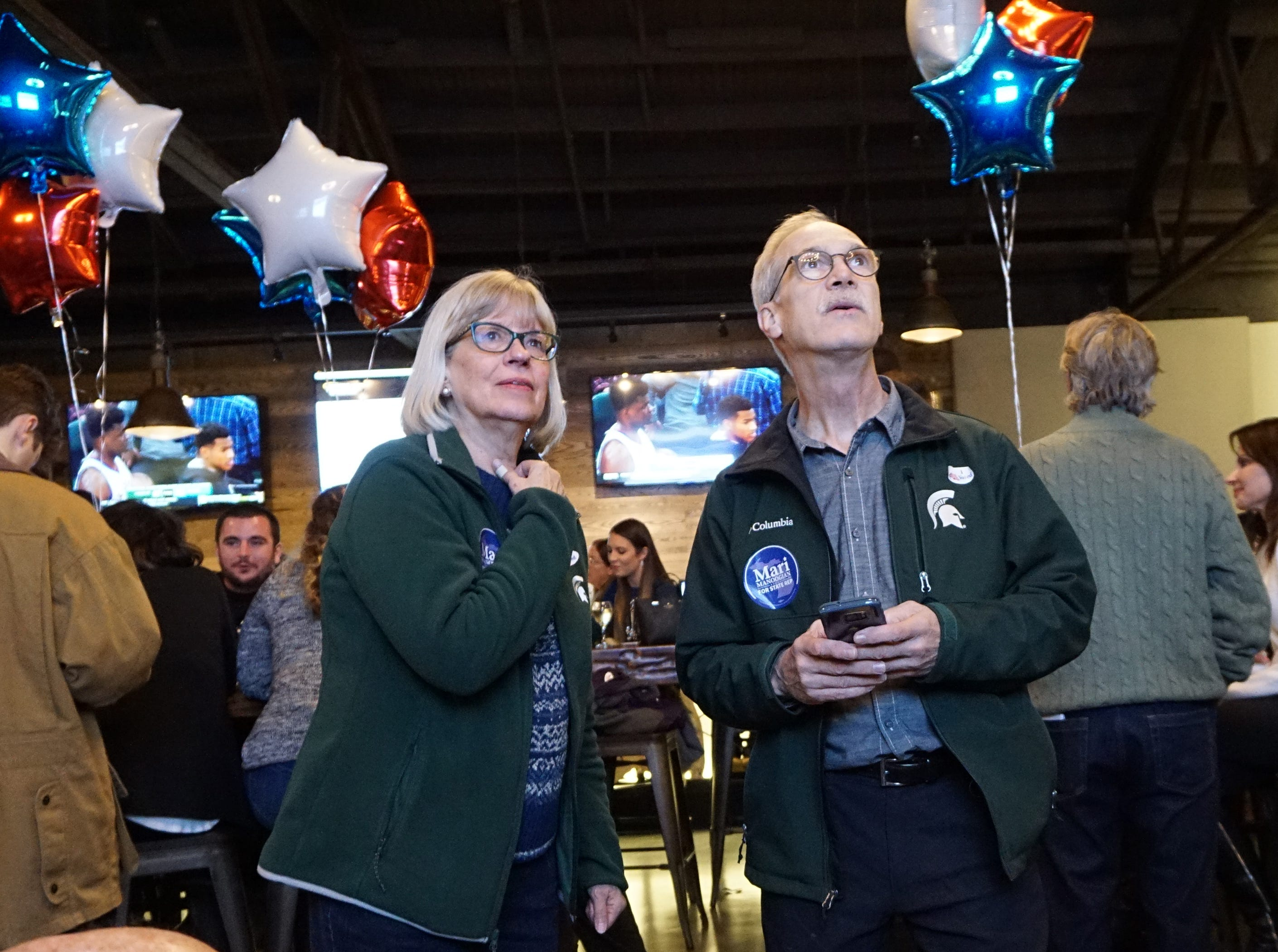 Ann and Ron Watts watch results at Dick O'Dow's during the election party for Mari Manoogian Nov. 6, 2018.