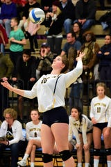 South Lyon's Chloe Grimes serves it up in Tuesday's regional semifinal against Skyline.