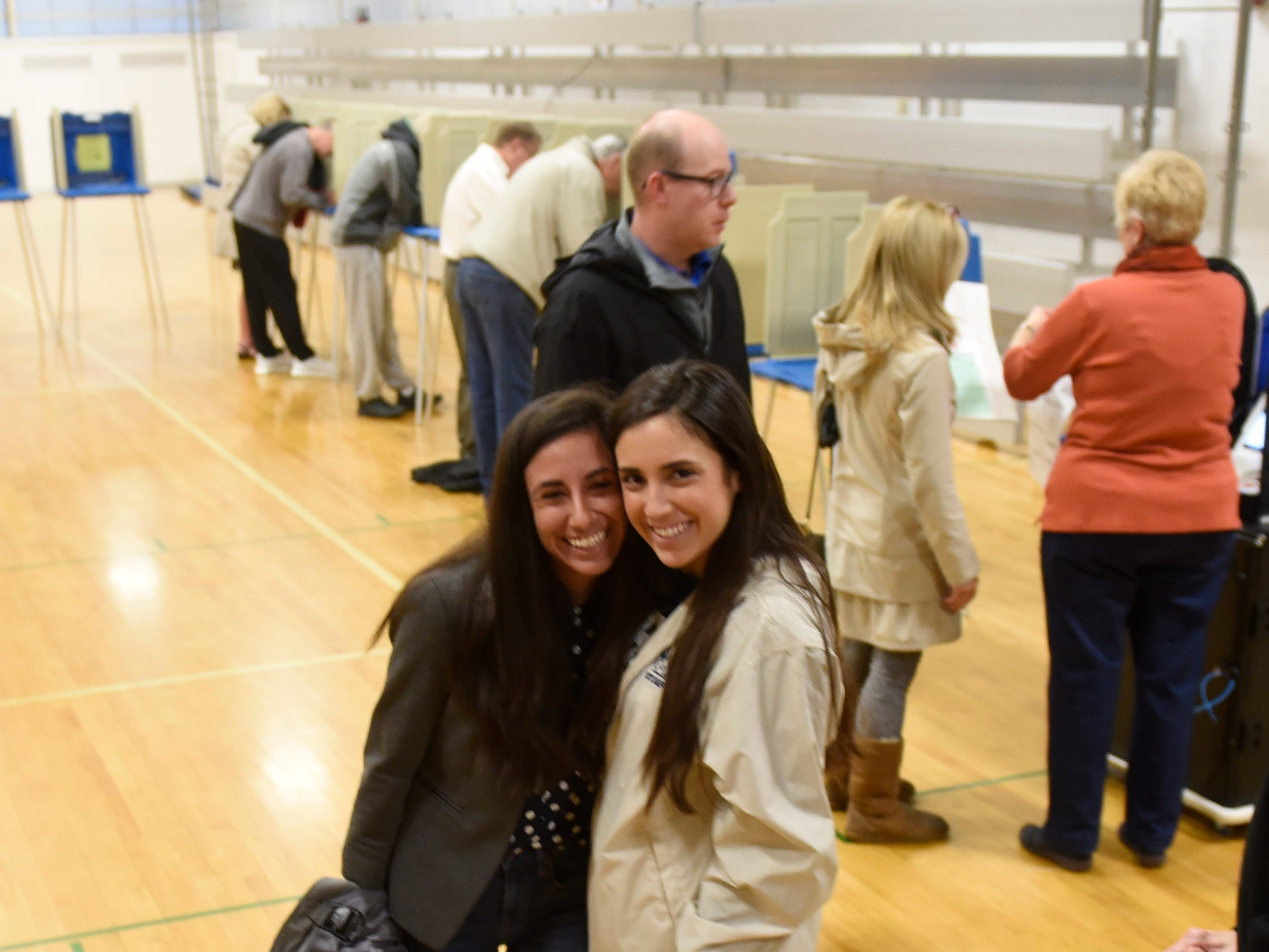 Mari Manoogian and her sister Alis Manoogian vote together at Derby Middle School on election day Nov. 6, 2018.