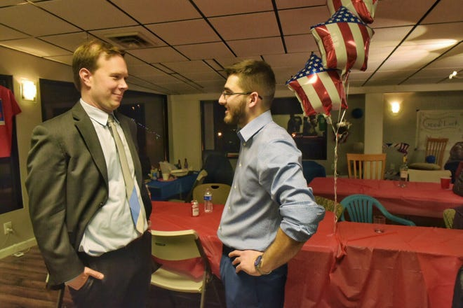 Matt Koleszar (left), talking with campaign manager Anthony Borden, appears to have pulled off an upset in the race for the state House 20th District.