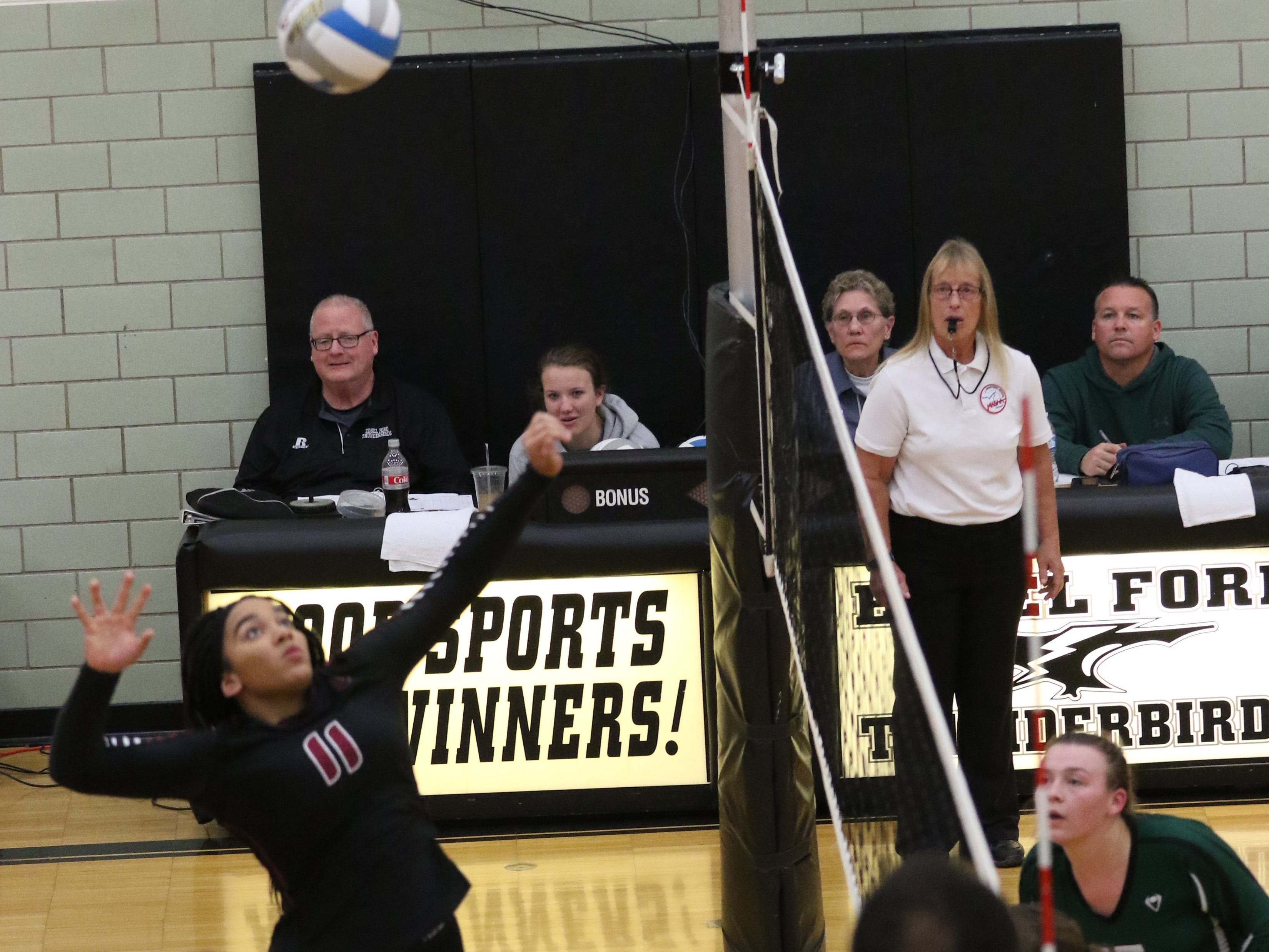 Winding up to blast the ball for Livonia Churchill is junior middle hitter Mya Grant (11).