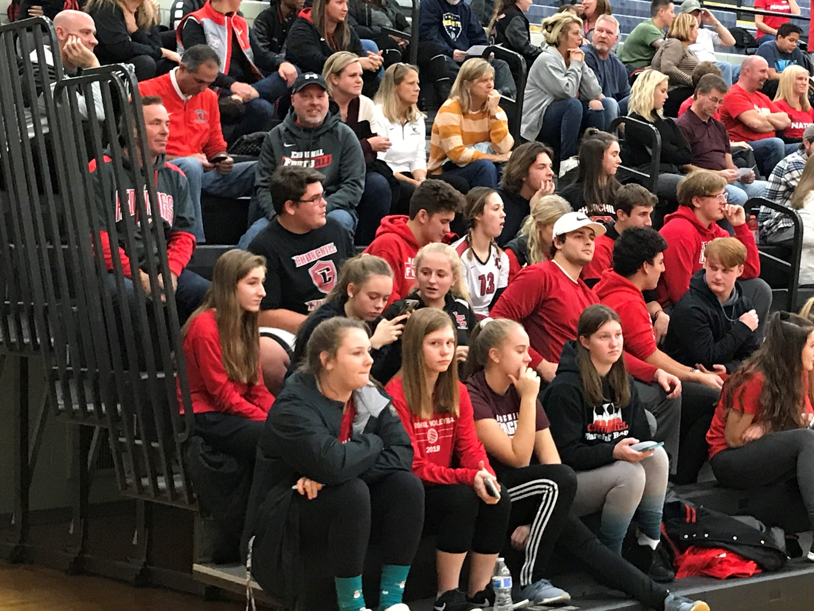 Livonia Churchill's cheering section gets into it during Tuesday's contest.