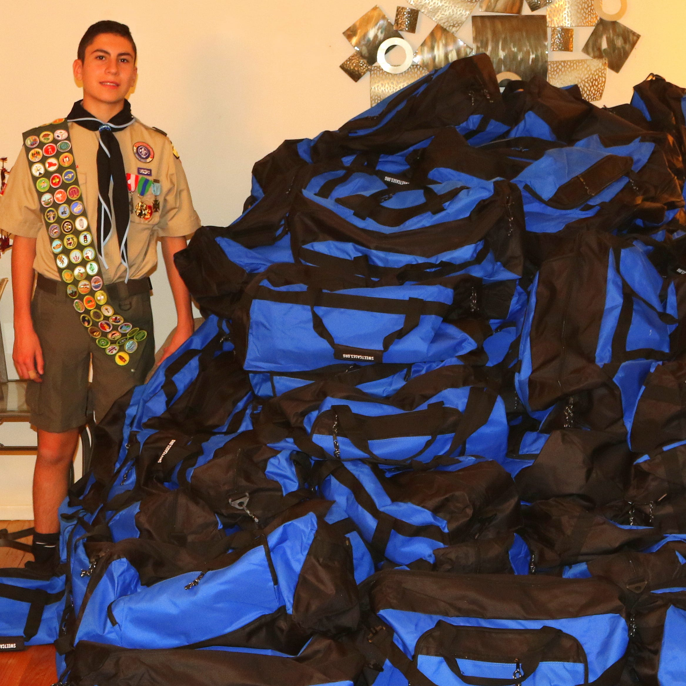Livonia Boy Scout donates duffel bags to foster children