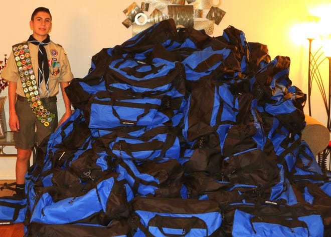 Livonia Scout George Atala, member of Troop 755 in Northville, raised money and donated duffel bags full of goods for foster children in Wayne County.