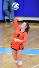 Setter Emma Stiles goes up for the serve in Northville's four-set regional semifinal win over Bedford.