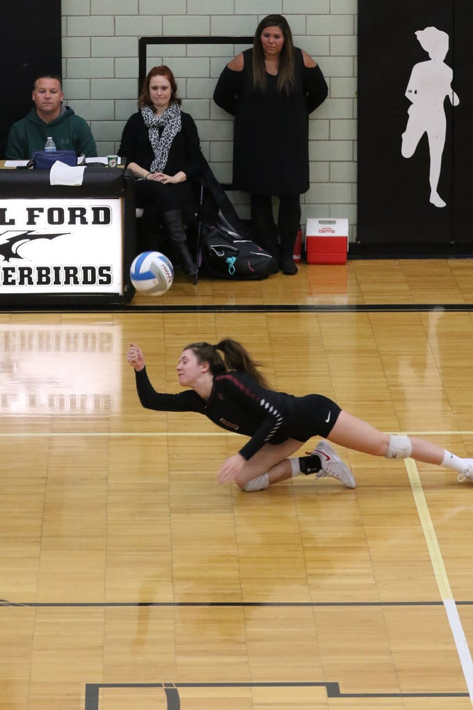 A common sight Tuesday: Livonia Churchill players diving to keep rallies going, in this photo it's Grace Vaeth (1) to the rescue.
