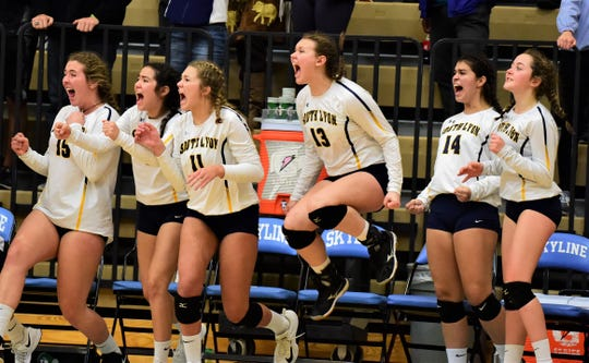 South Lyon players jump for joy after winning a point against Ann Arbor Skyline.
