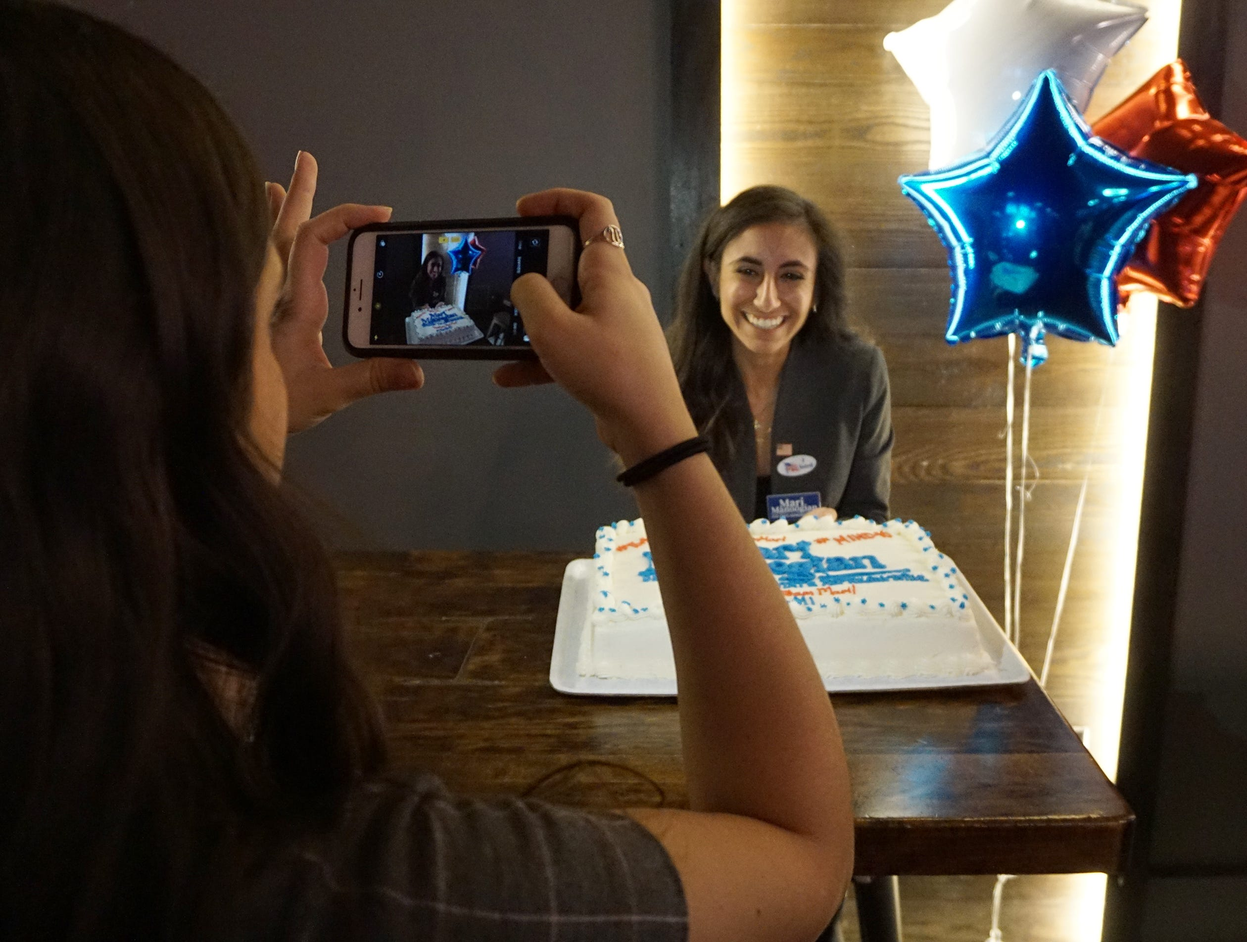 Mari Manoogian, candidate for state House District 40, poses for a photo with a celebration cake at her election night party at Dick O'Dow's Nov. 6, 2018.