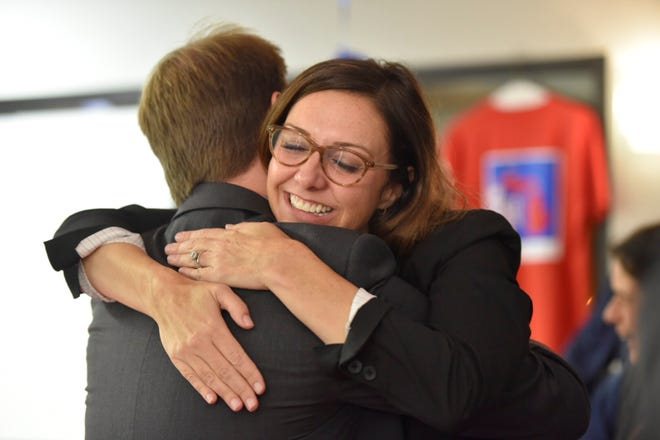 Democrat Dayna Polehanki, getting a hug from a supporter on election night, held a lead over Republican Laura Cox into the wee hours of Wednesday morning.