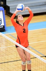 Northville senior setter Gabi Fisette makes the pass in a four-set regional semifinal win over Temperance Bedford.