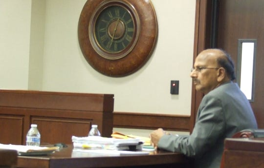 Dr. Hanumaiah Bandla, shown in court during his trial, on Tuesday was found not guilty of failing to report the abuse of a mental health patient. He was a psychiatrist at the Community Outreach for Psychiatric Emergencies clinic in Livonia and one of 10 people charged in connection with the alleged abuse of three patients.