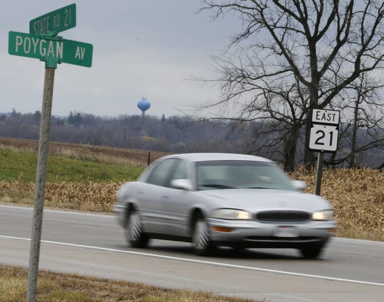 A car drives on State 21 on Tuesday, Nov. 6, 2018, at Poygan Avenue in the town of Rushford. Three people died since June in two crashes on the two-lane highway between Redgranite and Oshkosh, making it the deadliest road this year in Winnebago County.