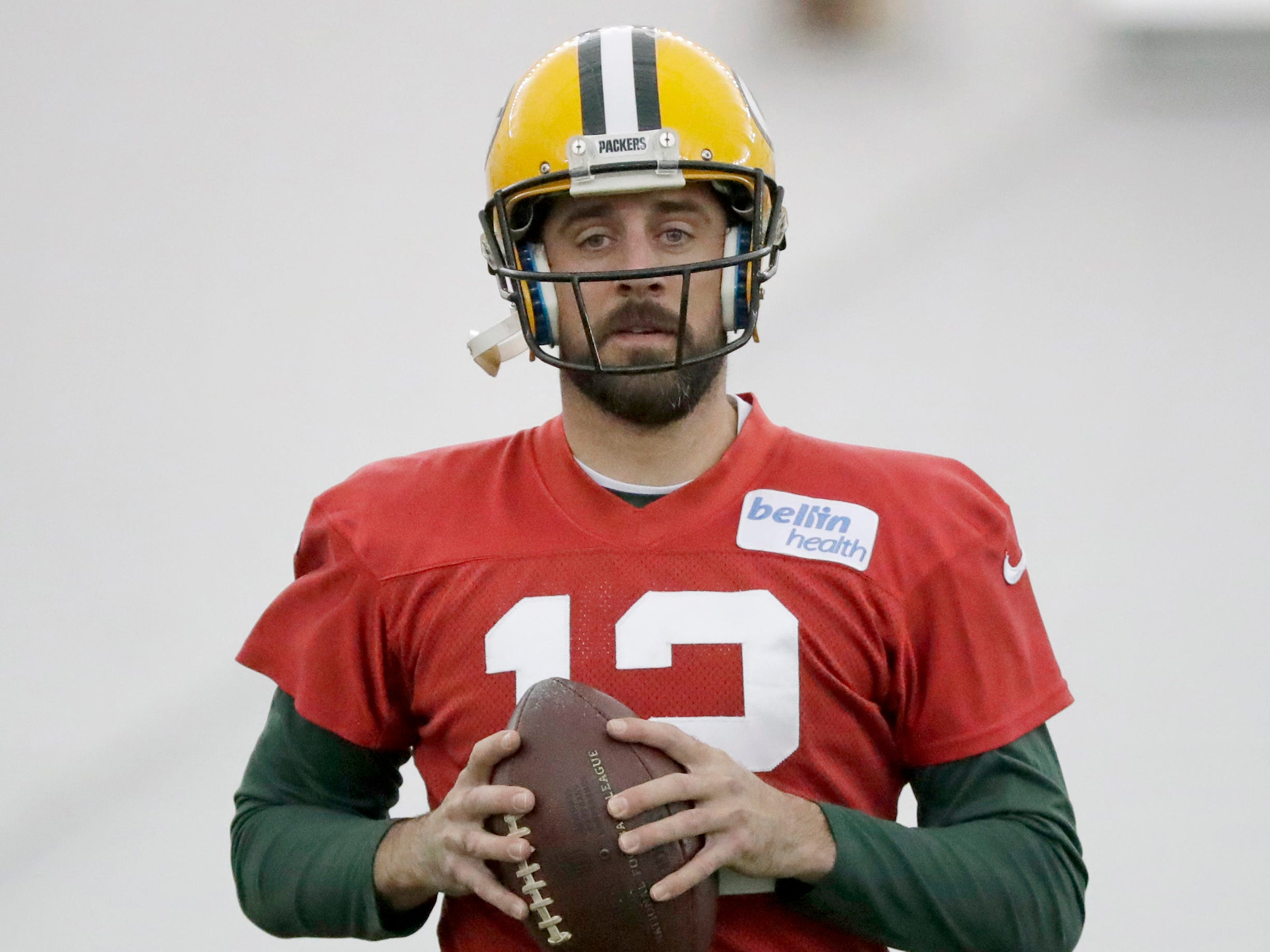 Green Bay Packers quarterback Aaron Rodgers (12) does a snap drill during practice Wednesday, November 7, 2018 at the Don Hutson Center in Ashwaubenon, Wis.