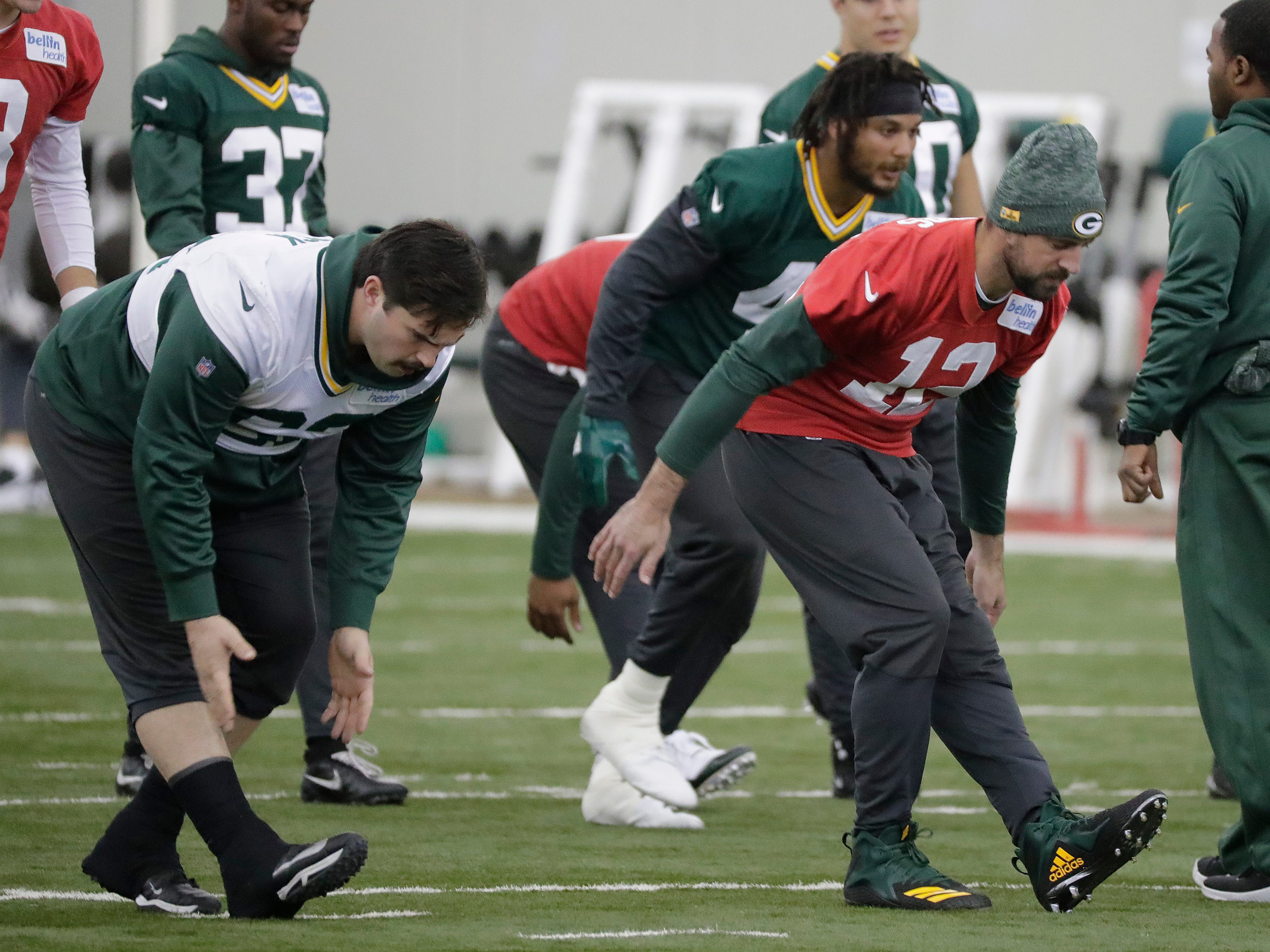 Green Bay Packers quarterback Aaron Rodgers (12) and offensive guard Lucas Patrick (62) stretch during practice Wednesday, November 7, 2018 at the Don Hutson Center in Ashwaubenon, Wis.