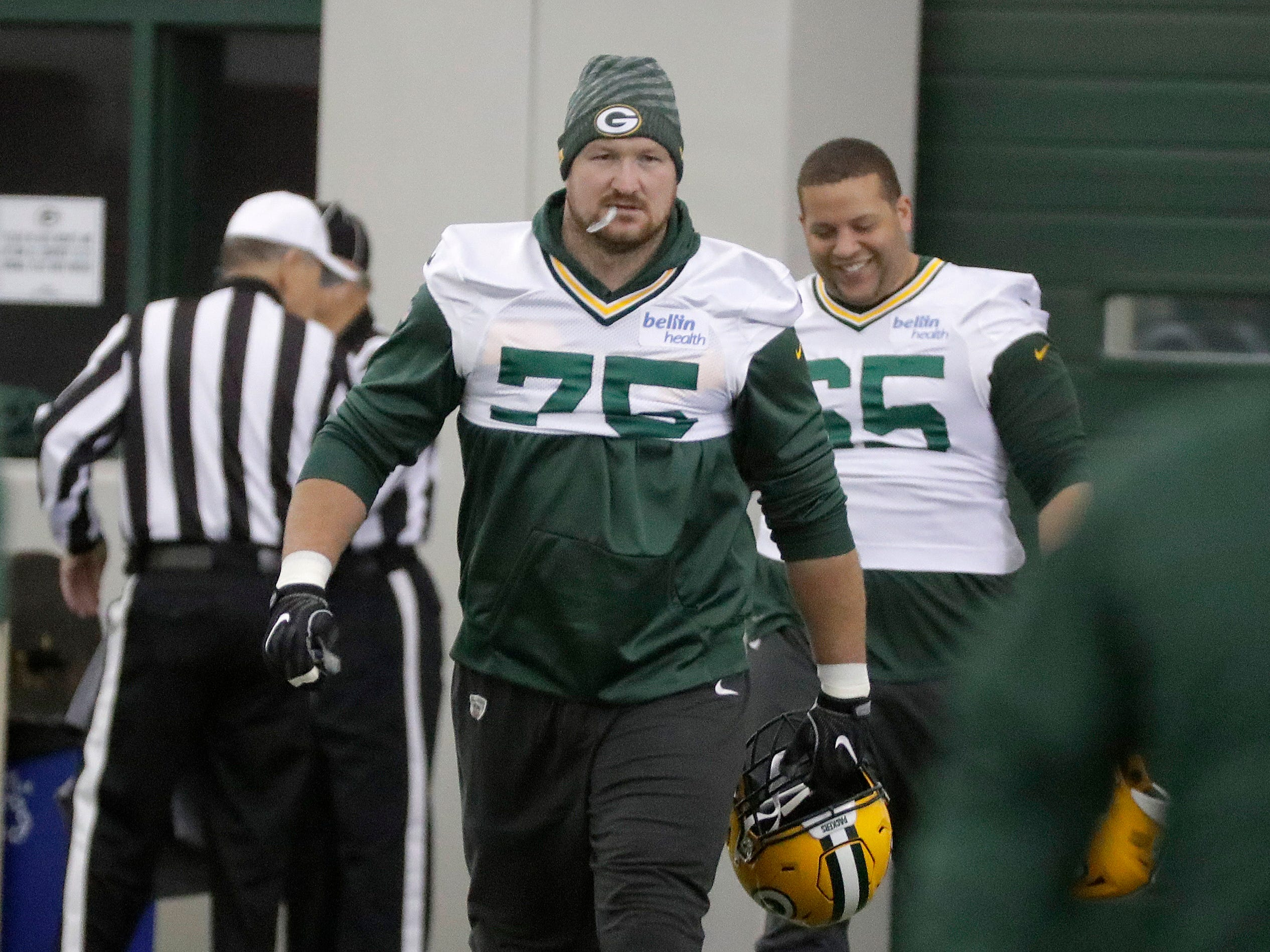Green Bay Packers offensive tackle Bryan Bulaga (75) arrives at practice Wednesday, November 7, 2018 at the Don Hutson Center in Ashwaubenon, Wis.