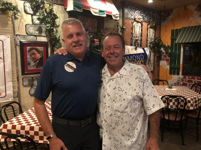 Council member-elect Ray Gregory, left, and Council member Mark Carnevale celebrate after favorable preliminary election returns Tuesday.