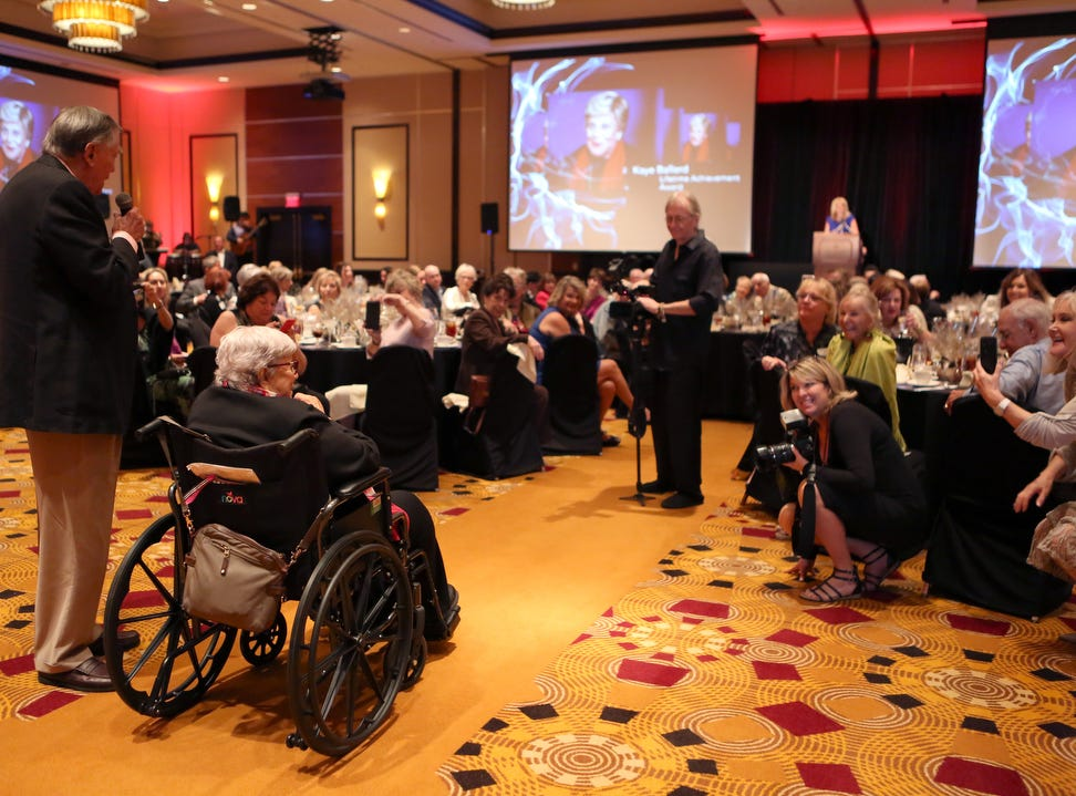 Lifetime Achievement Award recipient, Kaye Ballard, in wheelchair, and singer-comedian Peter Marshall speak during the 10th Annual Broken Glass Awards Monday at the Agua Caliente Casino Resort Spa in Rancho Mirage.