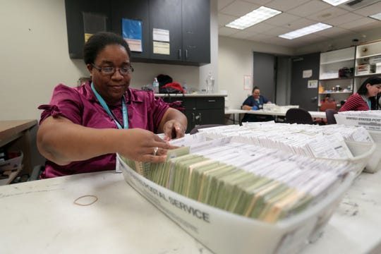 Election worker Kimberly Wright work with mail-in-ballots at County of Riverside Registrar of Voters in Riverside on Tuesday, November 6, 2018.