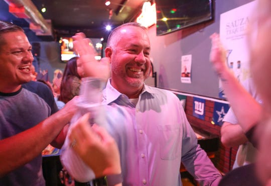 Scott Matas high fives his wife Victoria after the first election results come in in the Desert Hot Springs City Council race, November 6, 2018.