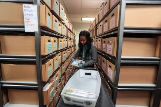 Election worker Jade Martin work with mail-in-ballots at County of Riverside Registrar of Voters in Riverside on Tuesday, November 6, 2018.