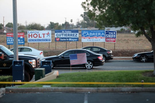 Campaign signs across the street from the County of Riverside Registrar of Voters in Riverside on Tuesday, November 6, 2018.