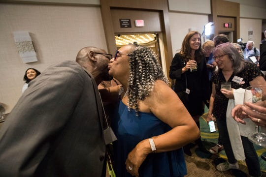 Deniantionette Mazingo greets her supporters at the Hilton Hotel in Palm Springs on election night November 7, 2018.
