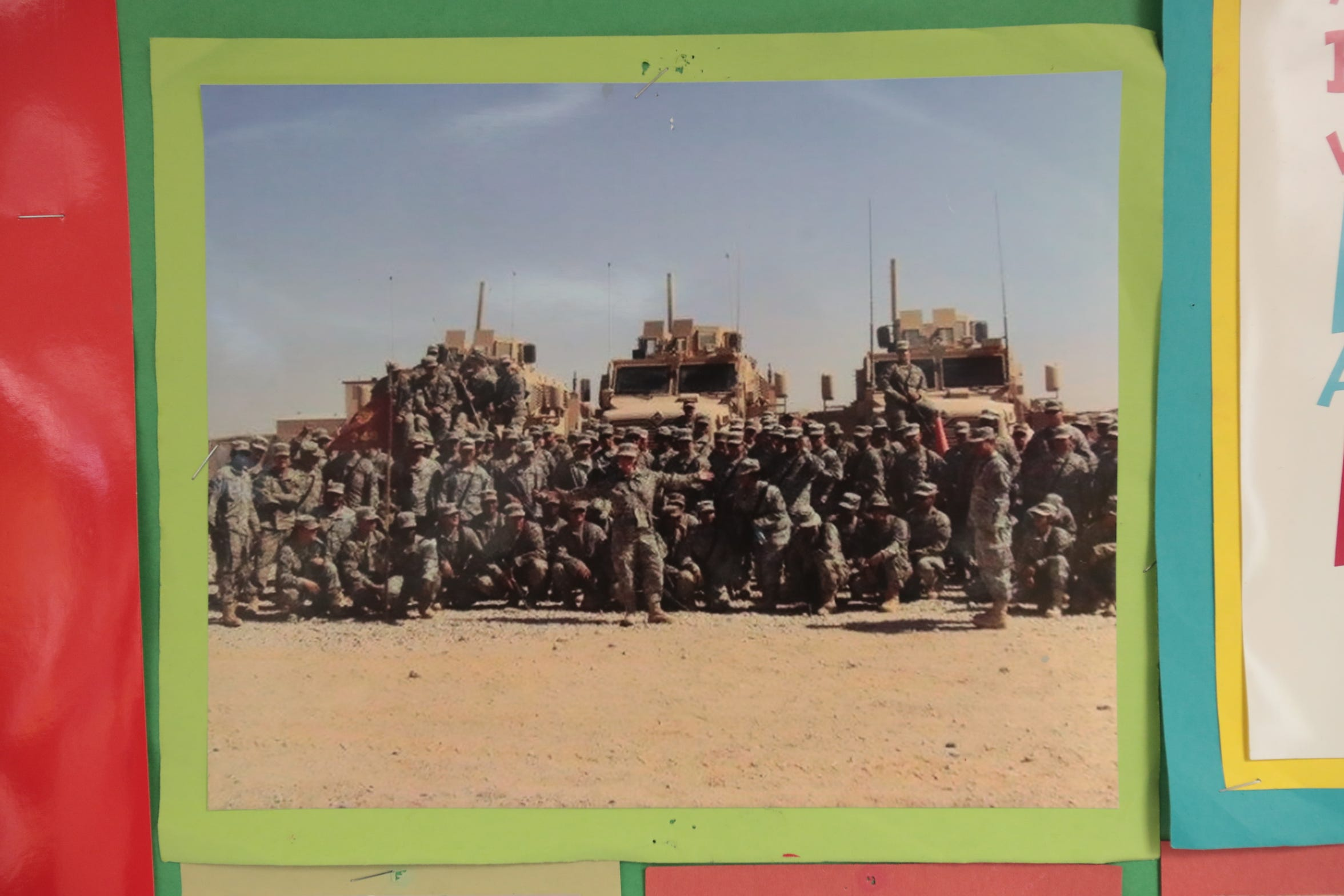 A photo of the 348th TC in Afghanistan hangs on retired U.S. Army Reserve Capt. Michelle Cherland's classroom at Lincoln Elementary on Wednesday, November 7, 2018 in Palm Desert.