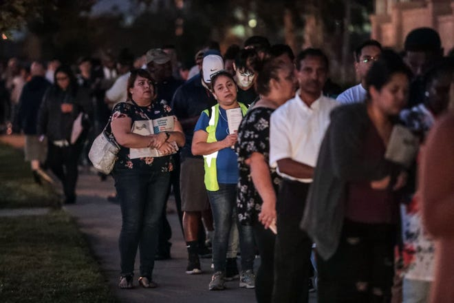 Voters wait in line at the Riverside County Registrar of Voters office in Riverside on Tuesday, Nov. 6, 2018. Many of those in line were seeking to register as well as vote.