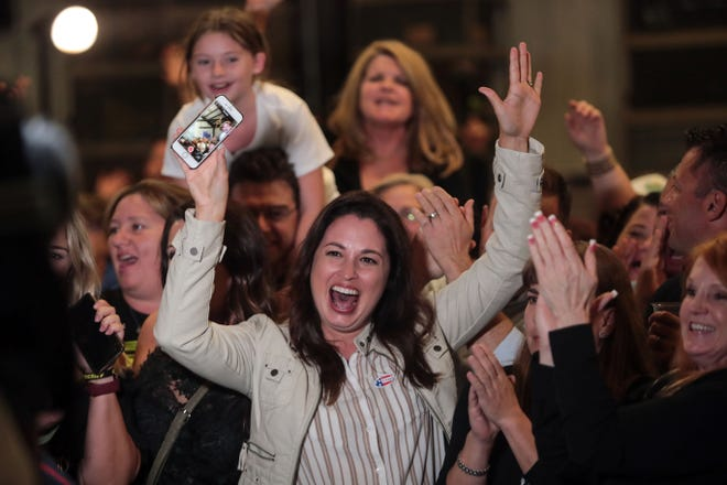 Riverside County Sheriff candidate Chad Bianco's supporters react to a TV camera during an interview at Bianco's election night party on Tuesday, November 6, 2018 at the March Airbase museum in Riverside.