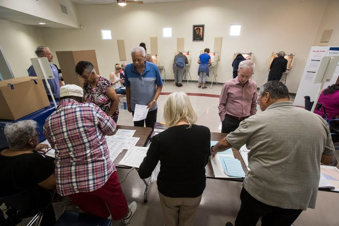 Voters exercise their right to vote at precinct 41-011 in Palm Springs, California on November 6, 2018 for the 2018 mid-term elections.