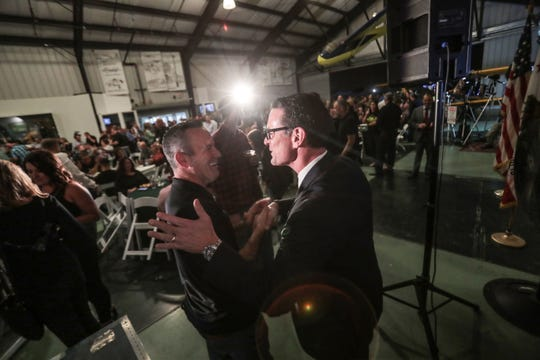 Riverside County Sheriff candidate Chad Bianco, left, with district attorney Mike Hestrin on Tuesday, November 6, 2018 at Bianco's election night party at the March Airbase museum in Riverside.